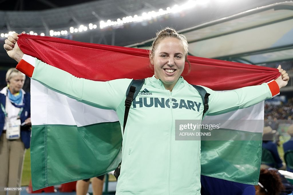 Bronze medallist Hungary's Anita Marton celebrates after the Women's Shot Put Final during the athletics event at the Rio 2016 Olympic Games at the Olympic Stadium in Rio de Janeiro on August 12, 2016. / AFP / Adrian DENNIS