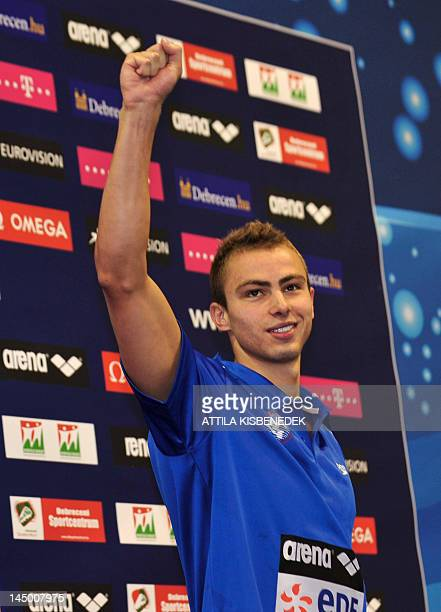 Bronze medallist Israel's Yakov Yan Toumarkin celebrates on the podium after competing in the final of the men's 100metre backstroke swimming event...