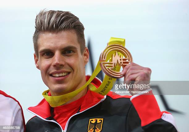 Bronze medallist Julian Reus of Germany pose on the podium during the medal ceremony for Men's 60 metres during day three of the 2015 European...