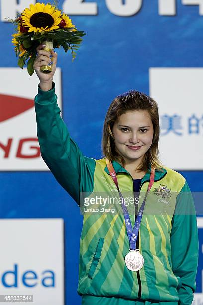 Bronze medallist Melissa Wu of Australia celebrates during the medal ceremony for the Women's Platform Final during day four of the 19th FINA Diving...