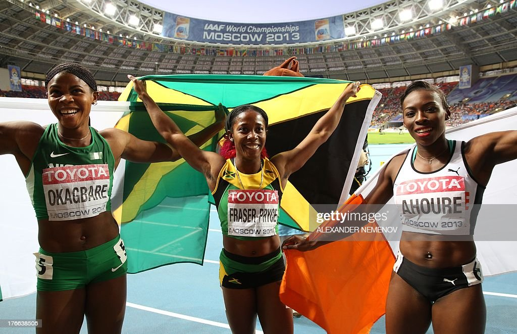 Bronze medallist Nigeria's Blessing Okagbare, winner Jamaica's Shelly-Ann Fraser-Pryce and silver medallist Ivory Coast's Murielle Ahoure pose after the women's 200 metres final at the 2013 IAAF World Championships at the Luzhniki stadium in Moscow on August 16, 2013. AFP PHOTO / ALEXANDER NEMENOV