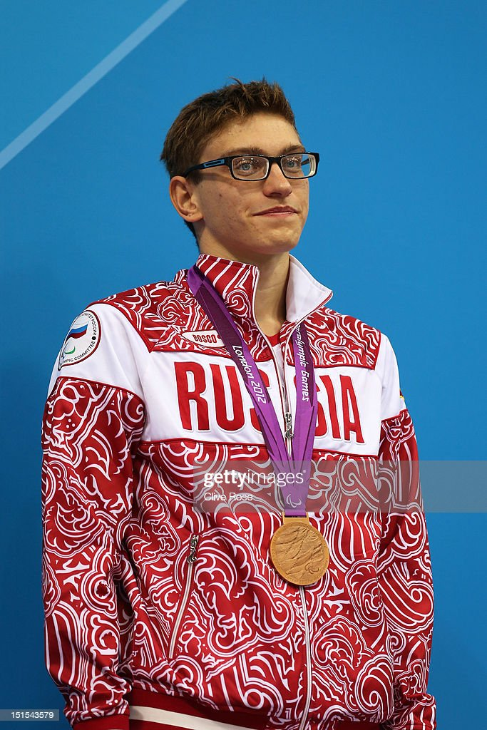 Bronze medallist Roman Dubovoy of Russia poses on the podium during the medal ceremony for the Men's 100m Breaststroke - SB13 final on day 10 of the London 2012 Paralympic Games at Aquatics Centre on September 8, 2012 in London, England.