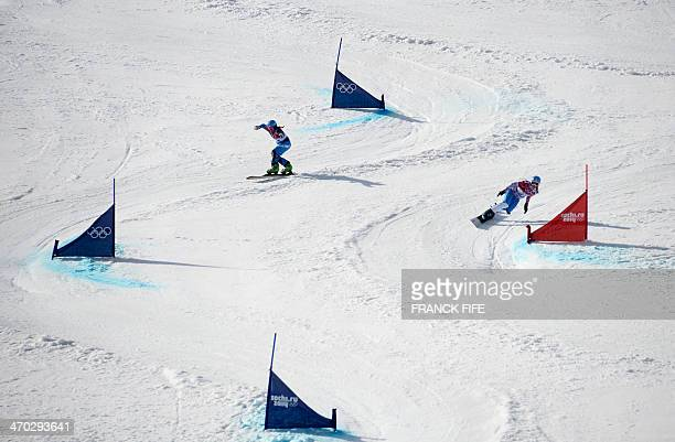 Bronze Medallist Russia's Alena Zavarzina and Austria's Ina Meschik compete in the Women's Snowboard Parallel Giant Slalom Final at the Rosa Khutor...