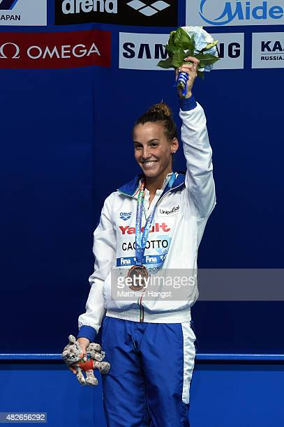 Bronze medallist Tania Cagnotto of Italy celebrates during the medal ceremony for the Women's 3m Springboard Diving Final on day eight of the 16th...