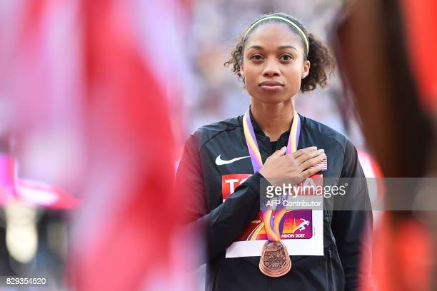 Bronze medallist US athlete Allyson Felix poses on the podium during the victory ceremony for the women's 400m athletics event at the 2017 IAAF World...