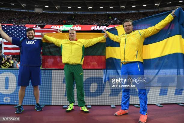 Bronze medallist US athlete Mason Finley gold medallist Lithuania's Andrius Gudius and silver medallist Sweden's Daniel Stahl pose after the final of...
