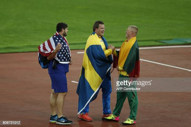 Bronze medallist US athlete Mason Finley silver medallist Sweden's Daniel Stahl and gold medallist Lithuania's Andrius Gudius share a joke after the...