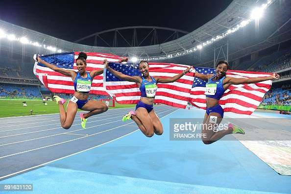 Bronze medallist USA's Kristi Castlin gold medallist USA's Brianna Rollins and silver medallist USA's Nia Ali celebrate after the Women's 100m...