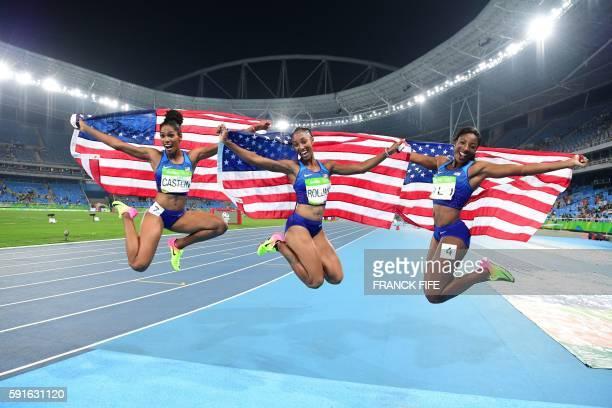 Bronze medallist USA's Kristi Castlin gold medallist USA's Brianna Rollins and silver medallist USA's Nia Ali celebrate after the Women's 100m...