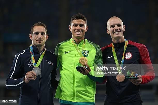 Bronze medallist USA's Sam Kendricks gold medallist Brazil's Thiago Braz Da Silva and silver medallist France's Renaud Lavillenie attend the medal...