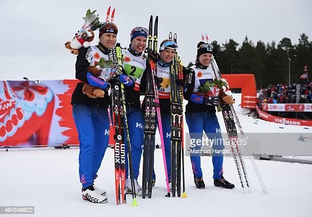 Bronze medallists AinoKaisa Saarinen Kerttu Niskanen RiittaLiisa Roponen and Krista Parmakoski of Finland celebrate after the Women's 4 x 5km...