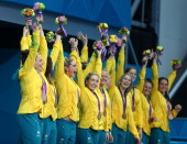 Bronze medallists Australia celebrate on the podium during the medal ceremony for the Women's Water Polo on Day 13 of the London 2012 Olympic Games...