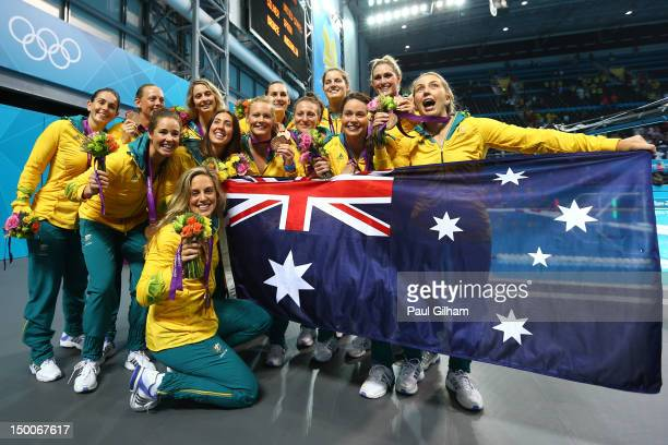 Bronze medallists Australia pose following the medal ceremony for the Women's Water Polo on Day 13 of the London 2012 Olympic Games at the Water Polo...
