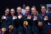Bronze medallists Elisa Blanchi Romina Laurito Marta Pagnini Andreea Stefanescu Anzhelika Savrayuk and Elisa Santoni of Italy celebrate during the...