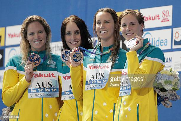 Bronze medallists Emily Seebohm Taylor McKeown Emma McKeon and Bronte Campbell of Australia pose during the medal ceremony for the Women's 4x100m...