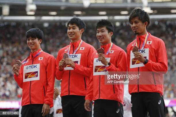 Bronze medallists Japanese team of Japan's Shuhei Tada Shota Iizuka Yoshihide Kiryu and Kenji Fujimitsu pose on the podium during the victory...