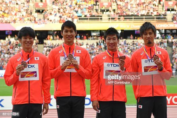 Bronze medallists Japan's Shuhei Tada Shota Iizuka Yoshihide Kiryu and Kenji Fujimitsu pose on the podium during the victory ceremony for the men's...
