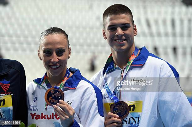 Bronze medallists Manila Flamini and Giorgio Minisini of Italy pose during the medal ceremony for the Mixed Duet Technical Synchronised Swimming...