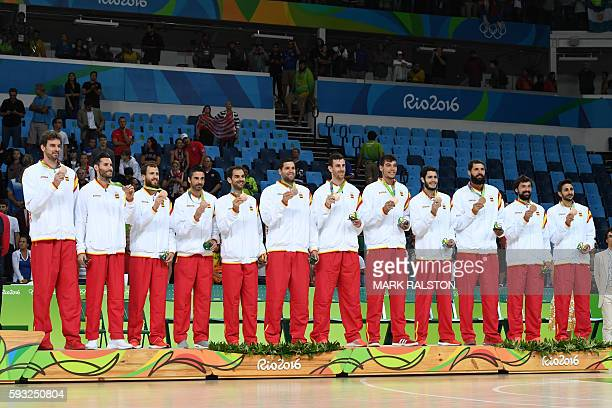 Bronze medallists Spain's centre Pau Gasol Spain's small forward Rudy Fernandez Spain's point guard Sergio Rodriguez Spain's guard JuanCarlos Navarro...