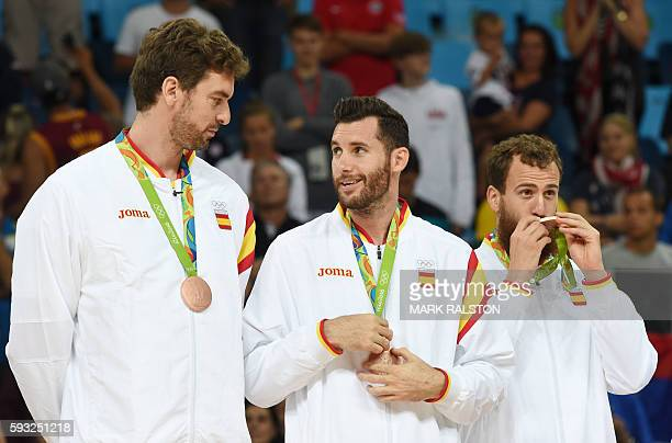 Bronze medallists Spain's centre Pau Gasol Spain's small forward Rudy Fernandez and Spain's point guard Sergio Rodriguez stand on the podium after...