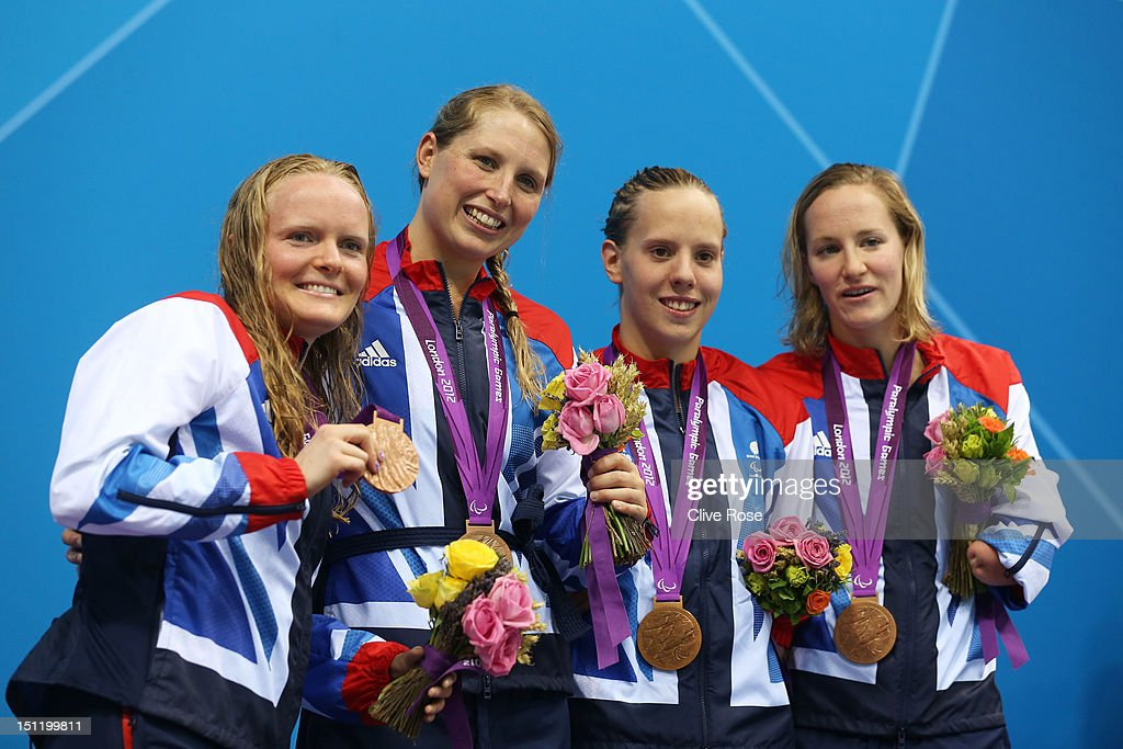 Bronze medallists Susannah Rodgers, Stephanie Millward, Louise Watkin and Claire Cashmore of Great Britain pose on the podium during the medal ceremony for the Women's 4x100m Free - 34pts final on day 5 of the London 2012 Paralympic Games at Aquatics Centre on September 3, 2012 in London, England.