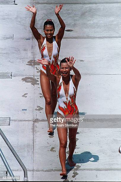 Bronze Miwako Motoyoshi and Saeko Kimura celebrate after competing in the Synchronized Swimming Duet final during the Los Angeles Summer Olympic...