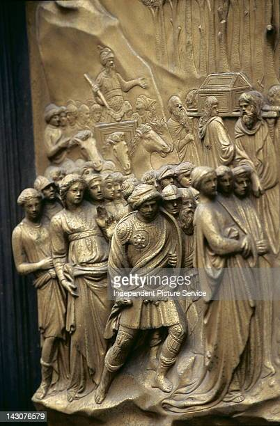 Bronze panel doors on the Baptistery of San Giovanni by Lorenzo Ghiberti Florence Italy This scene is a depiction of Joshua on a chariot preceded by...