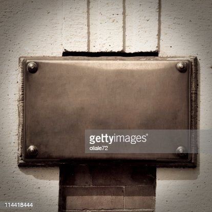Bronze Plaque on a Wall Background with Copy Space