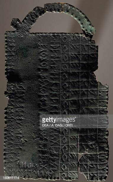 Bronze plate alphabet tablet engraved with a sequence of letters Votive object from the Sanctuary of Reithia Este Etruscan civilization 5th4th...