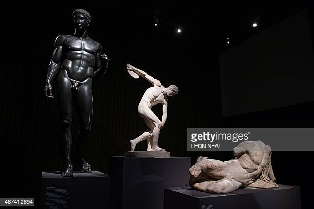 A bronze reconstruction of a lost Greek work a Roman copy of Myron's Discobolus and a marble figure from 438432 BC are displayed during a press...