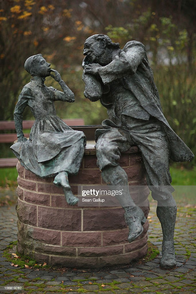 A bronze sculpture depicts a grandfather recounting a fairy tale to his dranddaughter on November 19, 2012 in Schoeneberg, Germany. Schoeneberg lies along the 'Fairy Tale Road' (in German: Die Maerchenstrasse) that leads through the region between Frankfurt and Bremen where the Grimm brothers collected and adapted most of their fairy tales, which include such global classics as Sleeping Beauty, Little Red Riding Hood, Rapunzel, Cinderella and Hansel and Gretel, in the early 19th century. The 200th anniversary of the first publication of the stories will take place this coming December 20th.