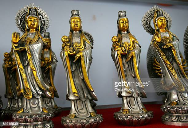 Bronze sculptures of Goddess of Mercy are displayed in the bronze factory at Gezhai Village on July 12 2008 in Yichuan County of Henan Province China...