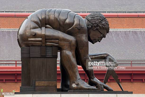 Bronze statue by Eduardo Paolozzi inspired by William Blake's famous image of English mathematician Sir Isaac Newton using a pair of dividers to plot...