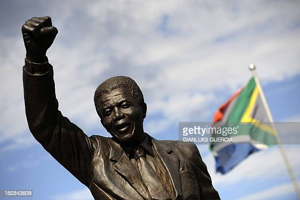 A bronze statue depicting former South African president Nelson Mandela as he walked to freedom in 1990 following his release after 27 years of...