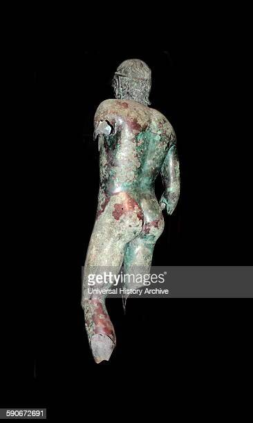 Bronze statue of a young man In ancient Greece and Rome Roman version of an earlier Greek statue It is made of polished bronze The eyes are silvered...