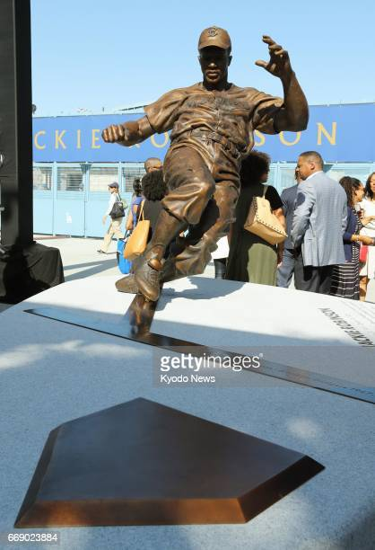A bronze statue of Jackie Robinson the first AfricanAmerican to play in Major League Baseball is unveiled outside the gates on the thirdbase side of...