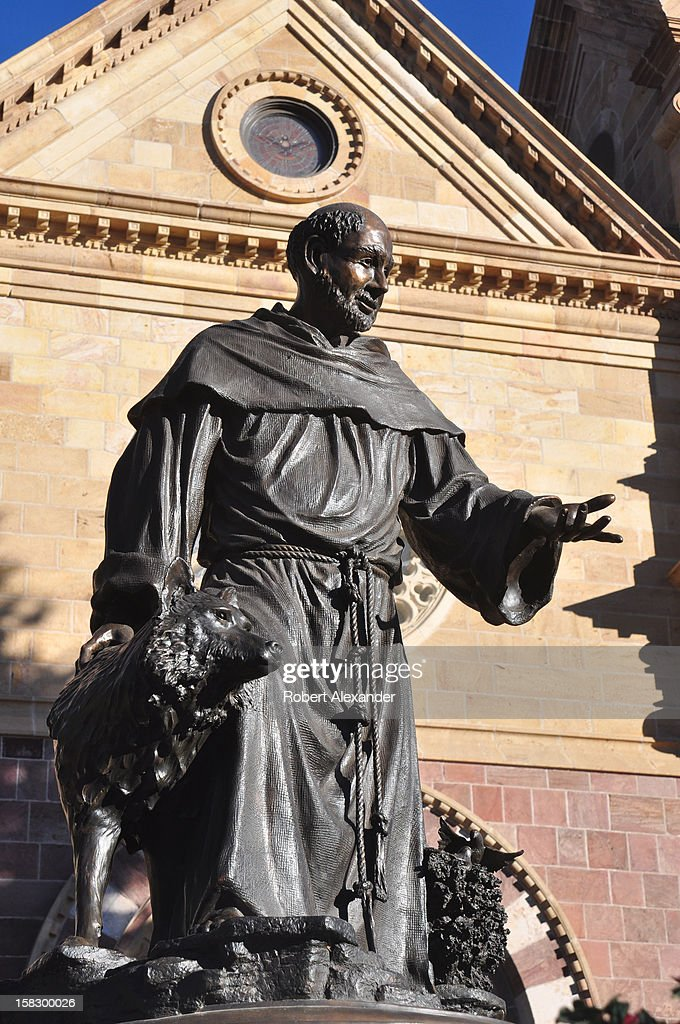 A bronze statue of Saint Francis of Assisi stands in front of the Cathedral Basilica of Saint Francis of Assisi in Santa Fe, New Mexico. (Photo by Robert Alexander/Archive Photos/Getty Images) 5104602RA_SantaFe173.jpg