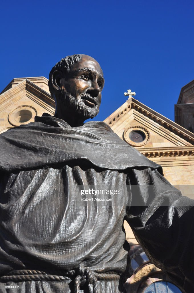 A bronze statue of Saint Francis of Assisi stands in front of the Cathedral Basilica of Saint Francis of Assisi in Santa Fe, New Mexico. (Photo by Robert Alexander/Archive Photos/Getty Images) 5104602RA_SantaFe176.jpg