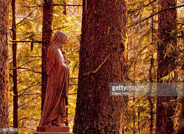Bronze statue  Saint Therese in forest in Alaska