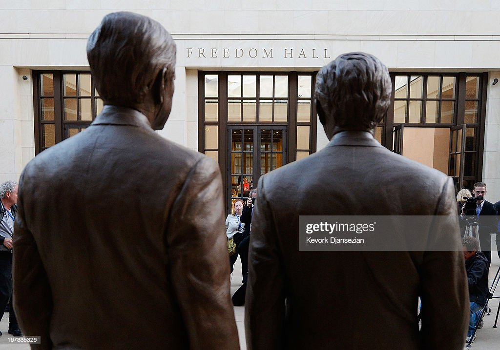 Bronze statues of former Presidents George W. Bush (R) and his father George H.W. Bush are on display during a tour of the George W. Bush Presidential Center on the campus of Southern Methodist University on April 24, 2013 in Dallas, Texas. Dedication of the George W. Bush Presidential Library is to take place on April 25 with all five living U.S. Presidents in attendance and an expected 8,000 people for the invitation-only dedication of the center