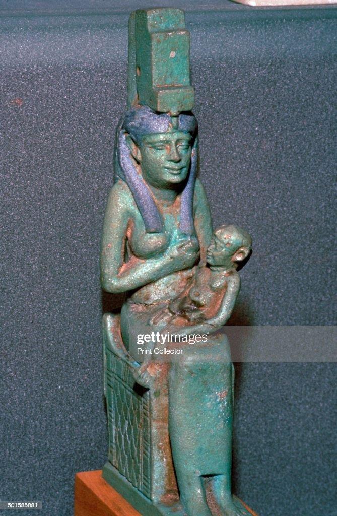 Bronze statuette of the Egyptian goddess Isis suckling Horus.