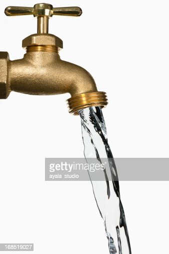 A bronze water faucet running isolated on white stock photo getty images - How to run plumbing collection ...