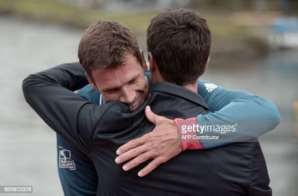 Bronze winner Slovakia's Peter Kauzer is congratulated by France's Tony Estanguet on the podium on the podium of the Canoe Men Slalom Final event of...