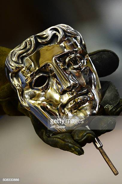 A bronzes face is readied of the iconic masks cast in to the BAFTA trophy for the 2016 British Academy of Film and Television Arts award ceremony at...