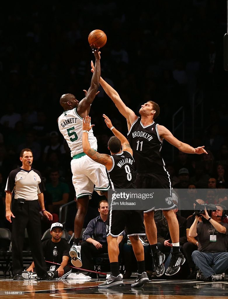 Brook Lopez #11 and Deron Williams #8 of the Brooklyn Nets defend against Kevin Garnett #5 of the Boston Celtics during a preseason game at the Barclays Center on October 18, 2012 in the Brooklyn borough of New York City. The Celtics defeated the Nets 115-85.