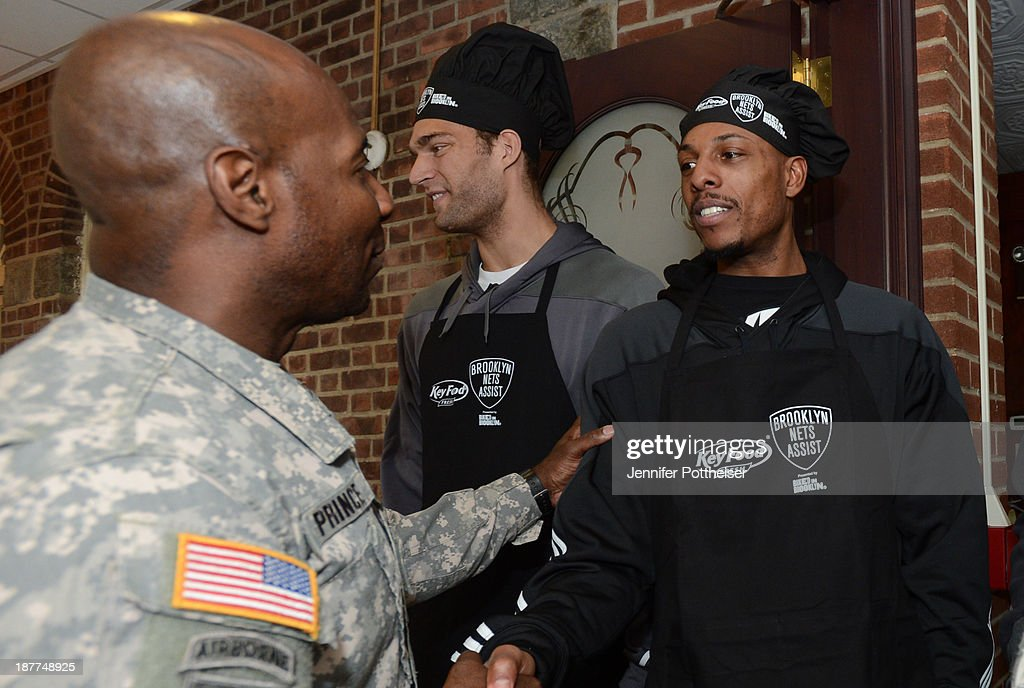 Brook Lopez #11 and Paul Pierce #34 of the Brooklyn Nets during a team event in celebration of Veterans Day at Ft. Hamilton, Brooklyn on November 11, 2013 in the Brooklyn borough of New York City.