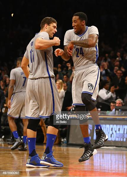 Brook Lopez and Rondae HollisJefferson of the Brooklyn Nets celebrate a 9088 win against the Atlanta Hawks at The Barclays Center on November 17 2015...