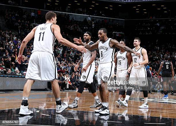 Brook Lopez and Sean Kilpatrick of the Brooklyn Nets react during the game against the LA Clippers on November 29 2016 at Barclays Center in Brooklyn...