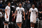 Brook Lopez Deron Williams and Joe Johnson of the Brooklyn Nets during the game against the Phoenix Suns on March 6 2015 at Barclays Center in...