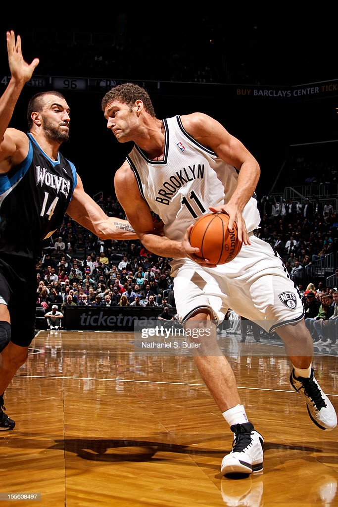 Brook Lopez #11 drives against Nikola Pekovic #14 of the Minnesota Timberwolves on November 5, 2012 at the Barclays Center in Brooklyn, New York.